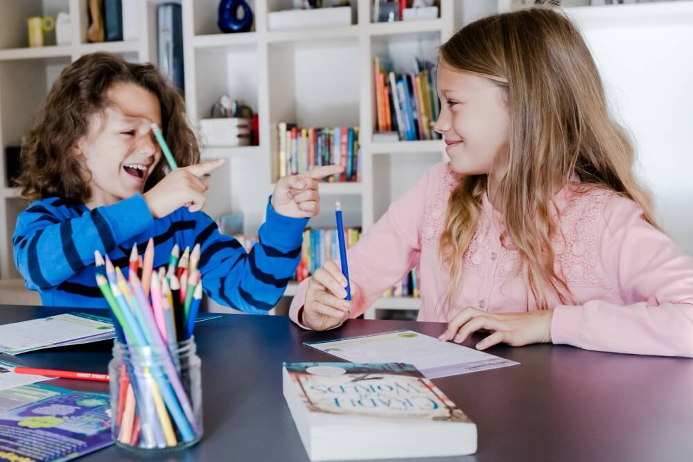 Children with book and activity pack